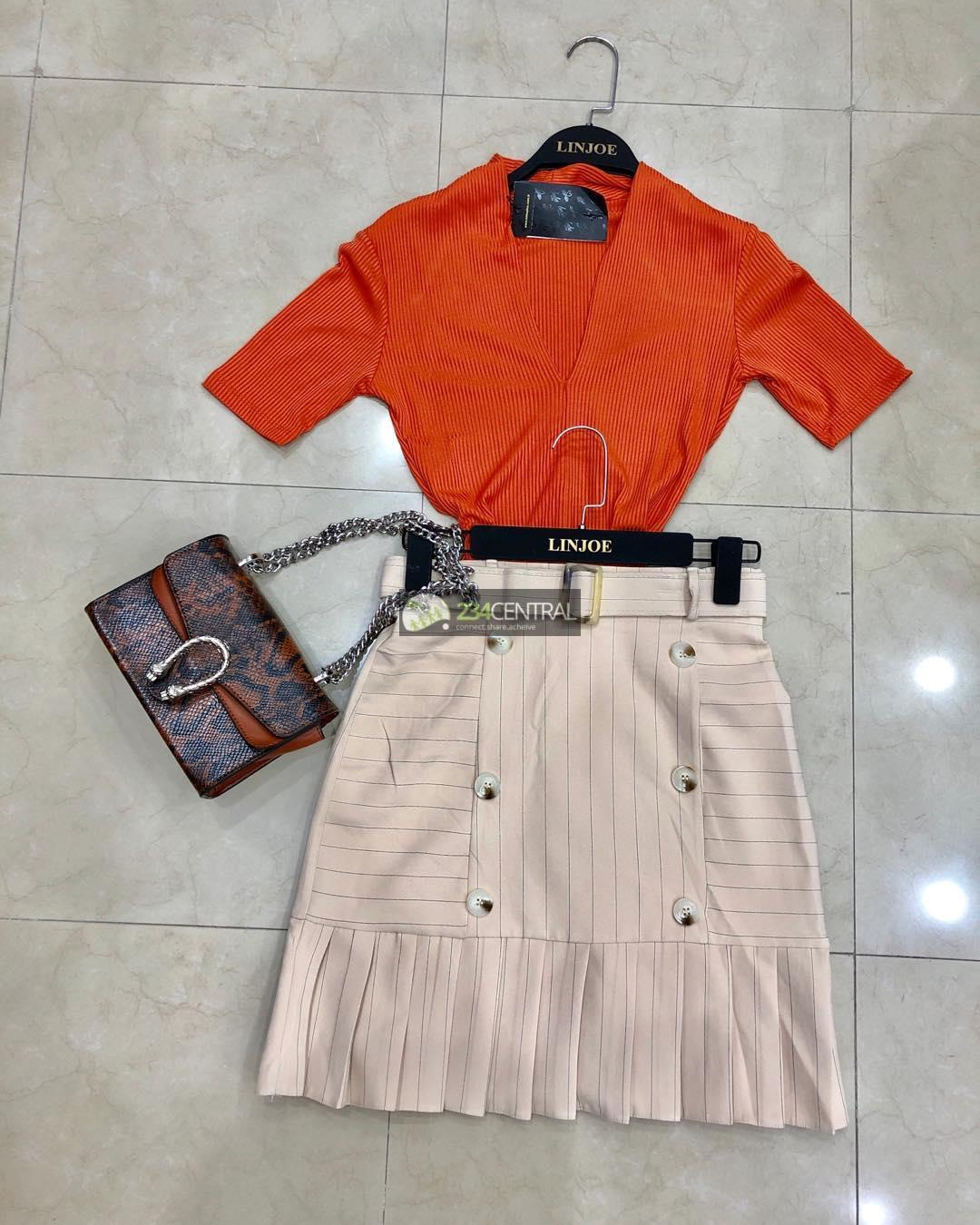 Bodysuit orange color top, Nude color Skirt and Bag